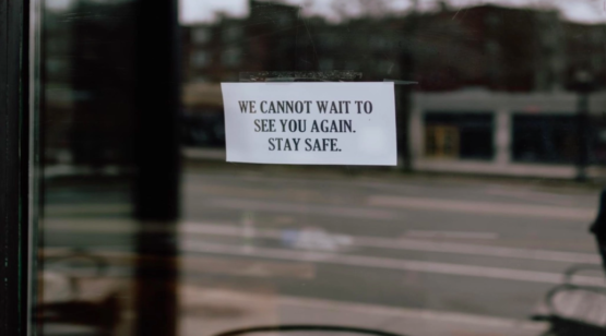 """""""A sign on a door saying We cannot wait to see you again, stay safe"""""""
